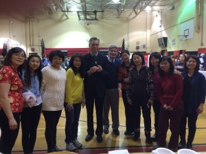Syosset School District Superintendent, Dr. Rogers and HBT Principal, Mr. Kassebaum pose with Chinese parents at Multicultural Expo 2015